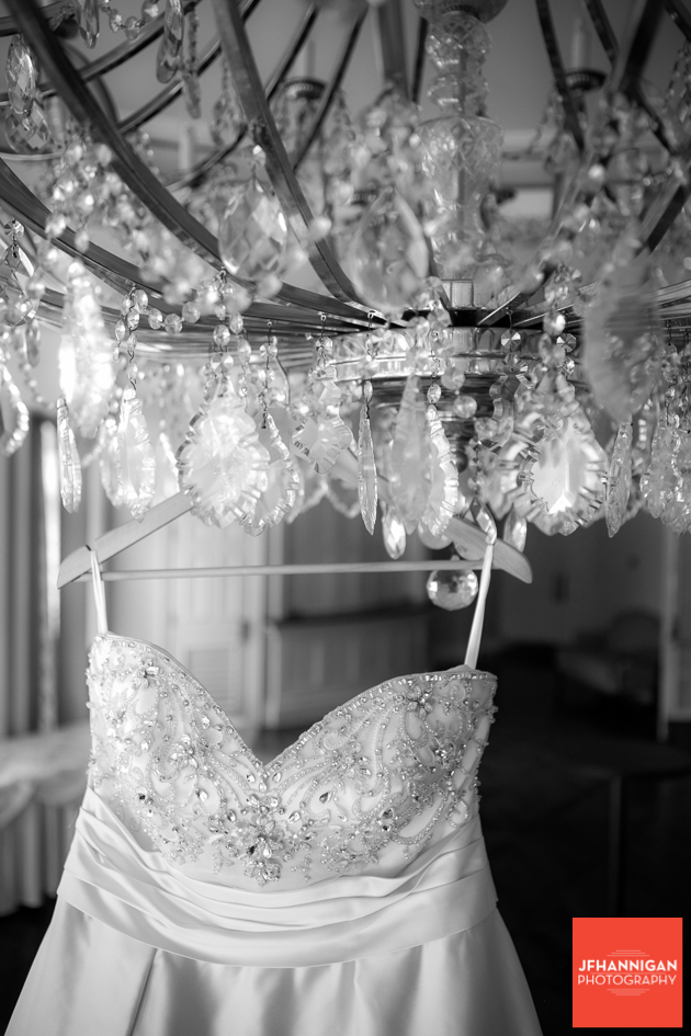 bridal gown hung from chandelier