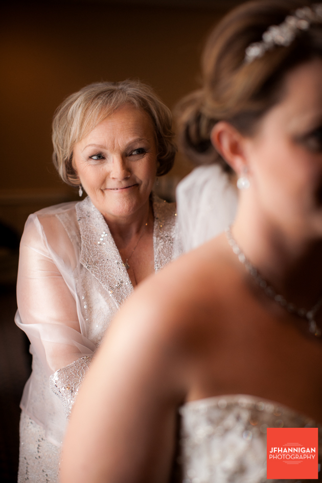 Mom does up bride's gown