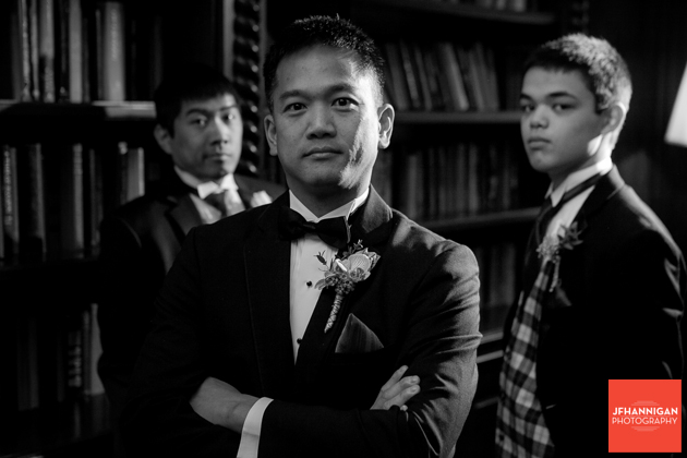 groom and groomsmen in library