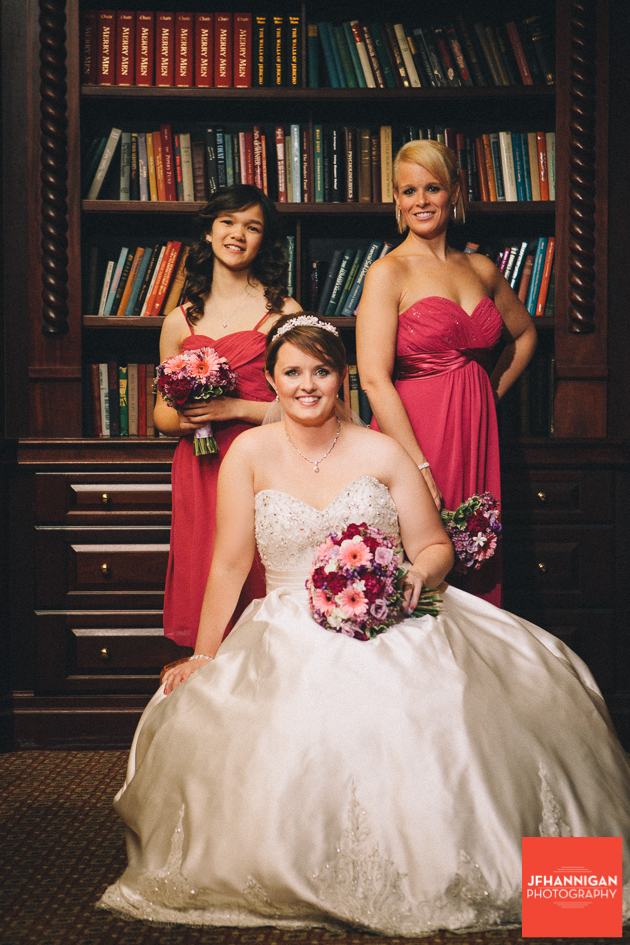bride and bridesmaids in library