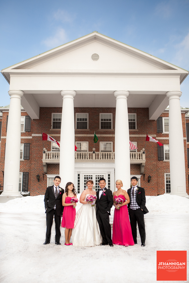 wedding party in snow in front of Queen's Landing