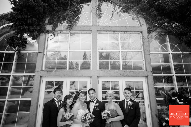 wedding party in front of glass windows