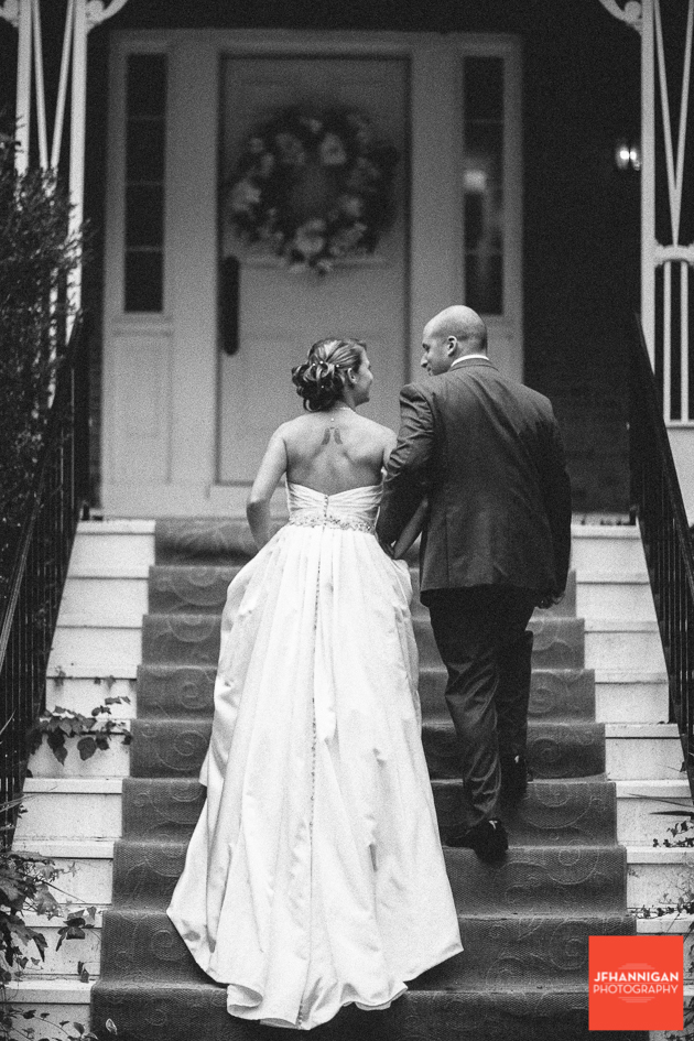 bride and groom walking up steps with trian