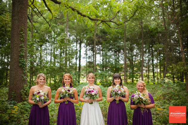 bridal party in purple in wooded area