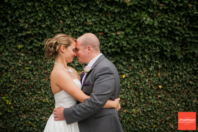 bride and groom foreheads touching in embrace
