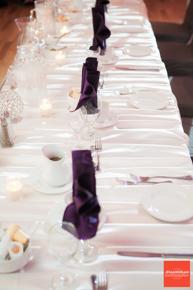 head table with purple napkins