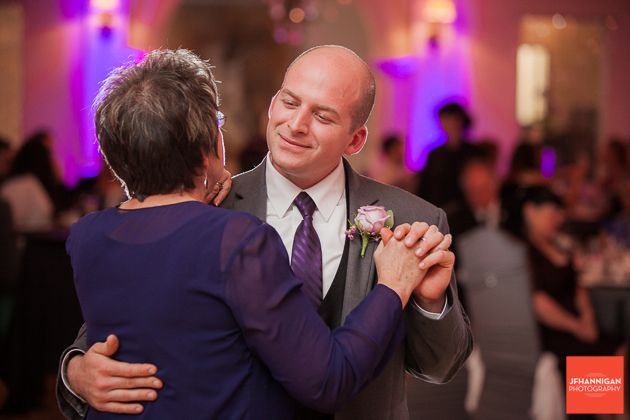 groom and mother dance purple lights in background