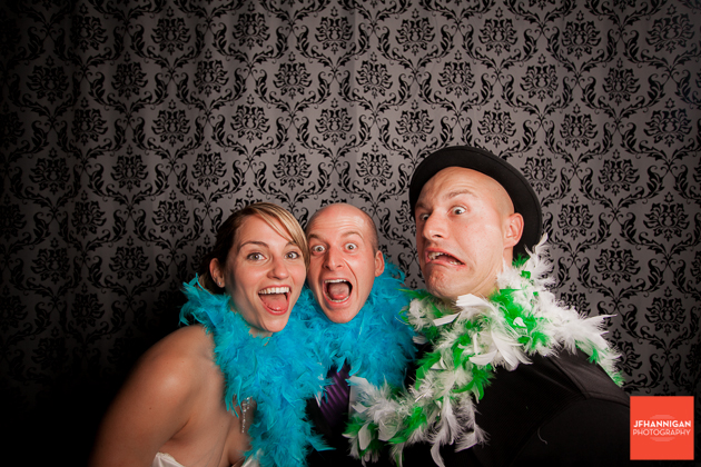 bride, groom and wedding photographer in photobooth