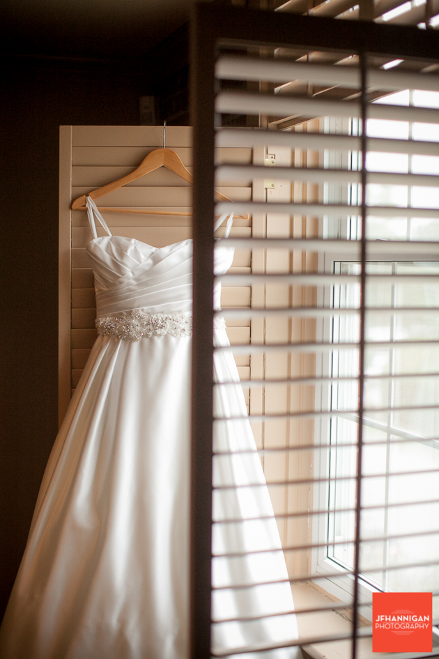 bridal gown throught window shutter