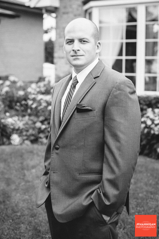 groom in black and white photo