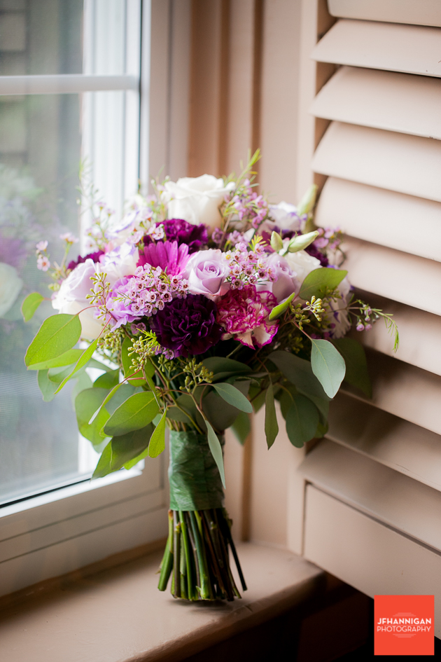 bridal bouquet in white and purple on window sill