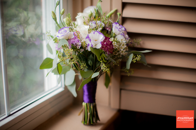 bridesmaid's bouquet in purple an white on window sill