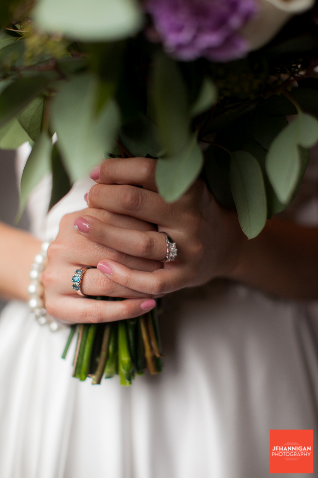 hands with rings holding bridal bouquet