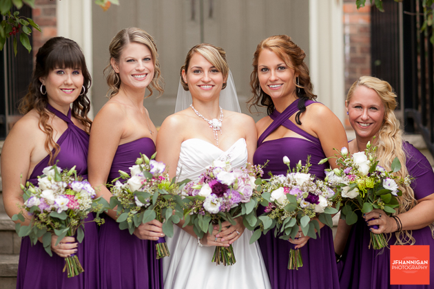 bride and bridesmaid's wearing purple