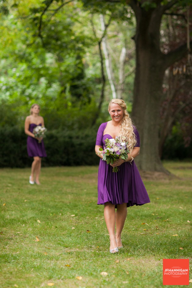bridesmaid in purple at outdoor wedding