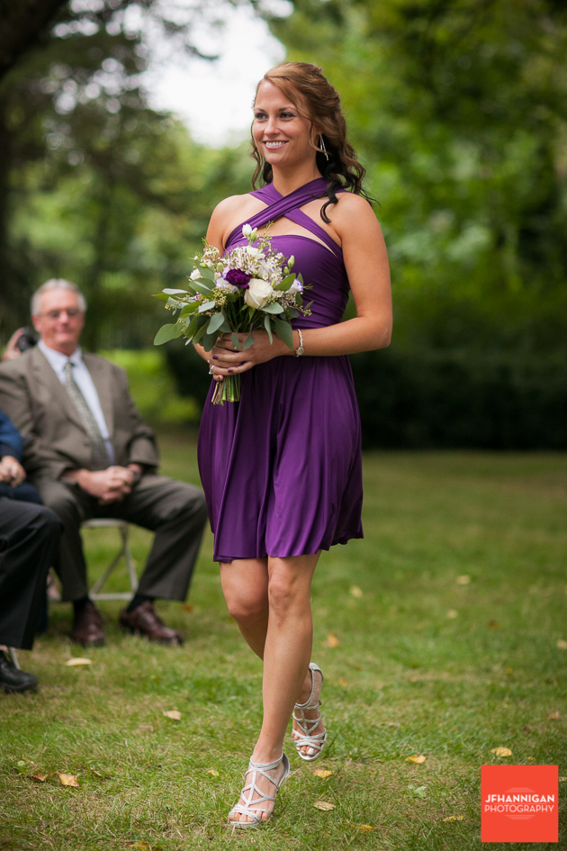 bridesmaid dressed in purple at outdoor wedding