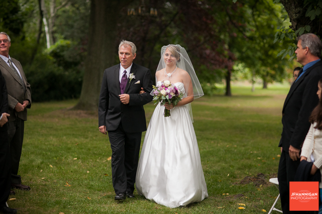 bride and father entrance at outdoor wedding