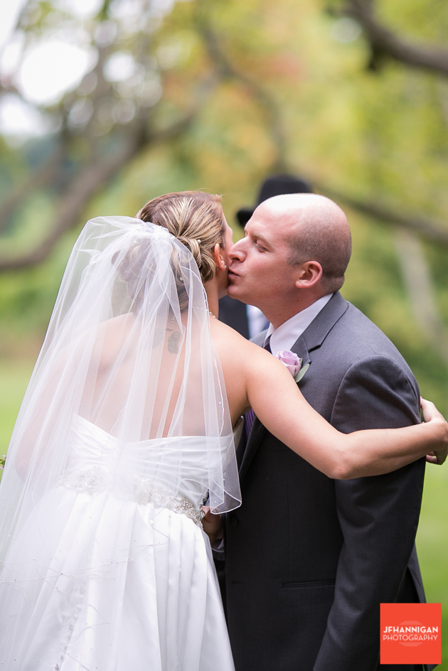 groom kisses bride