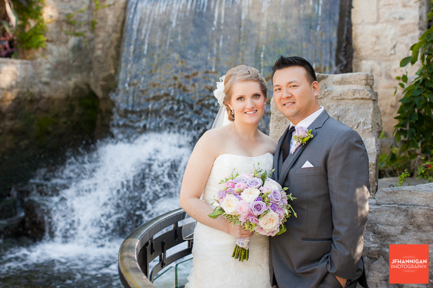 bride and groom pictured by waterfalls at Ancaster Mill