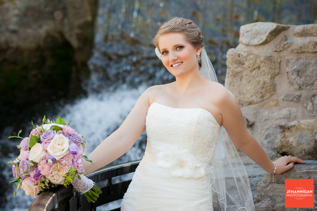 bride with waterfalls in background