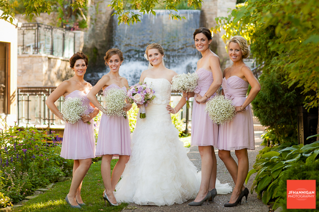 bridal party in mauve with waterfalls in background