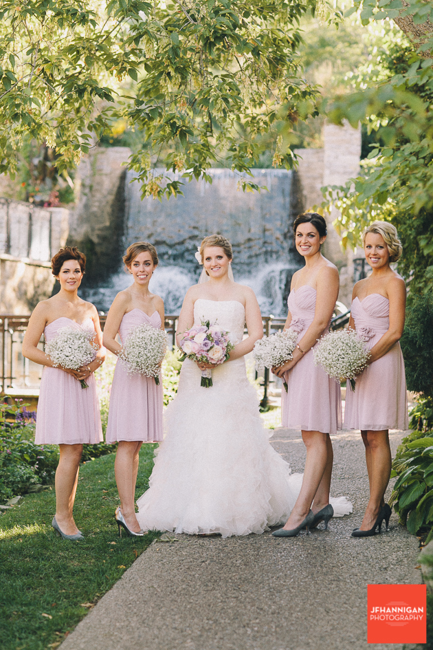 bridal party with mauve dresses and baby's breath bouquet