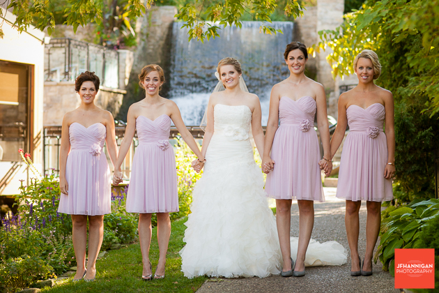 bridal party with waterfalls of Ancaster Mill in background