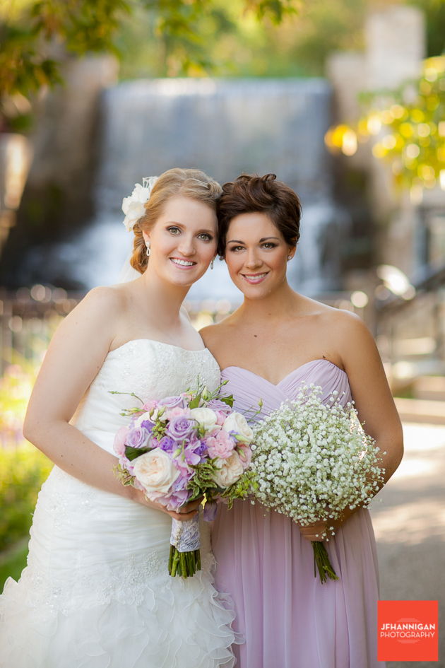 bride and bridesmaid at waterfalls at Ancaster Mill