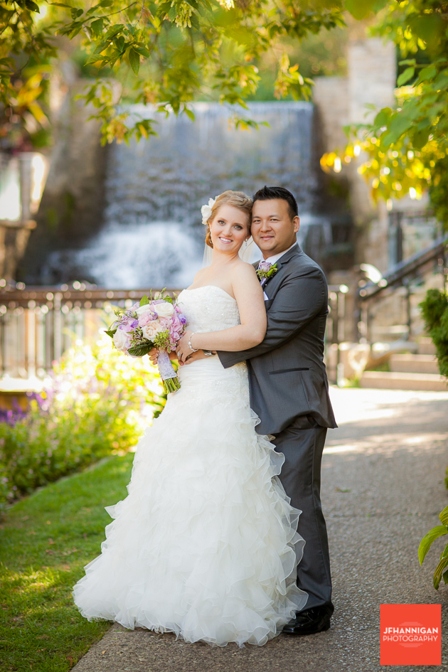 bride and groom at waterfalls of Ancaster Mill