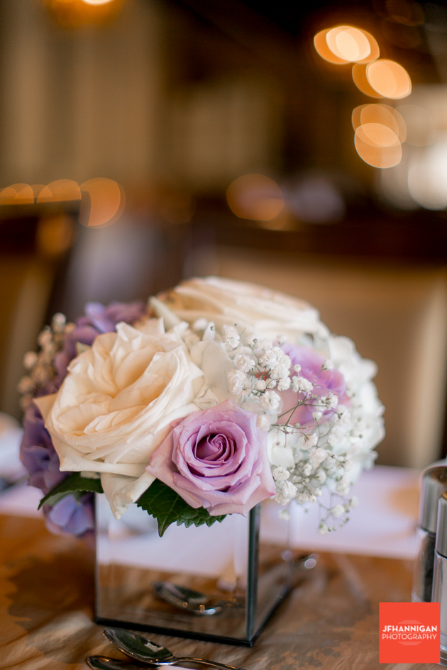 reception table flowers in mauve and pink