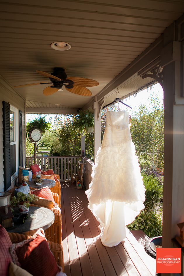 bridal dress hung on porch