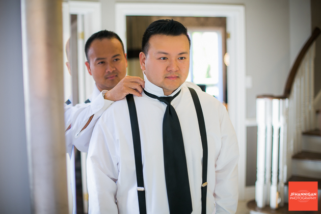 adjusting groom's tie and collar