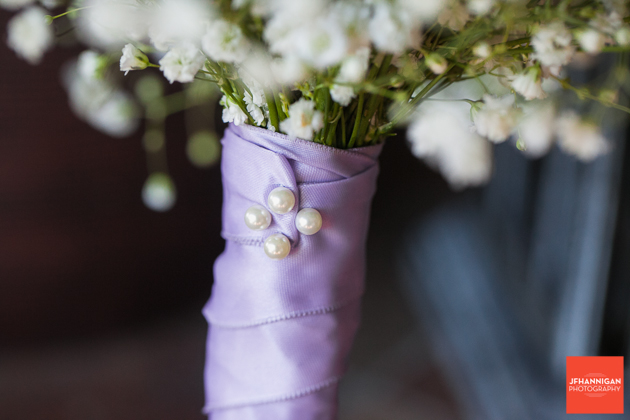 bridesmaid bouquet with baby's breath and mauve ribbon
