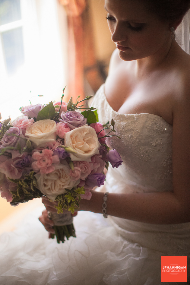 bride with mauve and pink bouquet