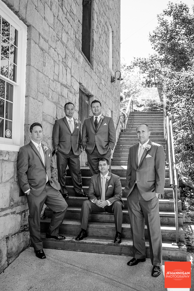 groom and ushers on stairs