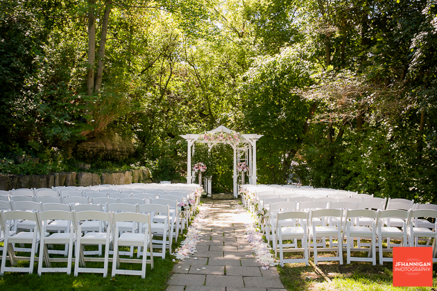 outdoor wedding setteing with trees in green foliage