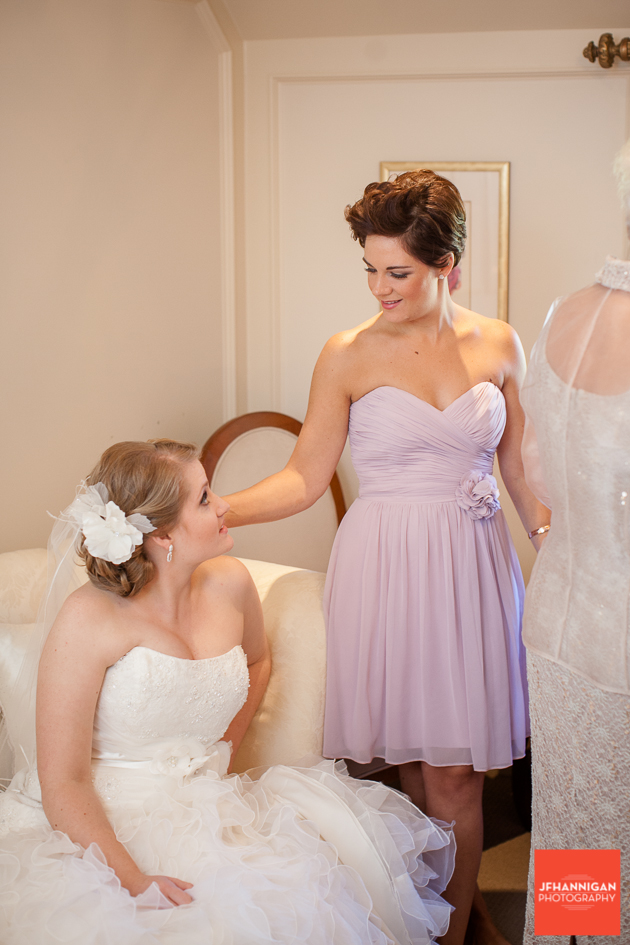 bridesmaid dressed in mauve with bride before ceremony