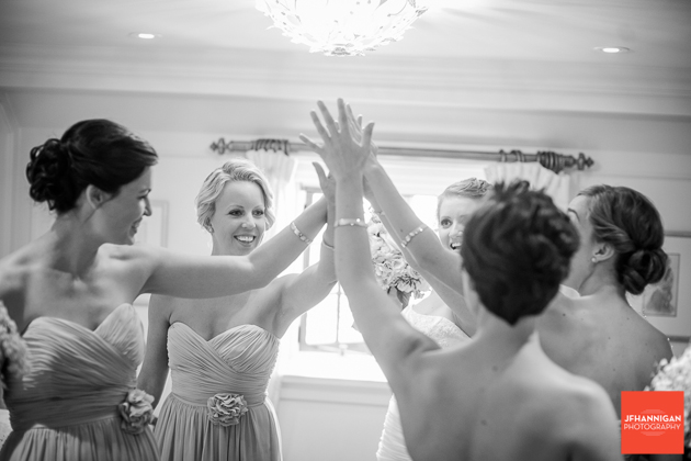 bride and bridesmaid high five before wedding ceremony