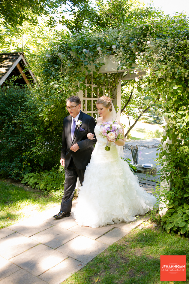 bride and father enter outdoor wedding ceremony mauve accents