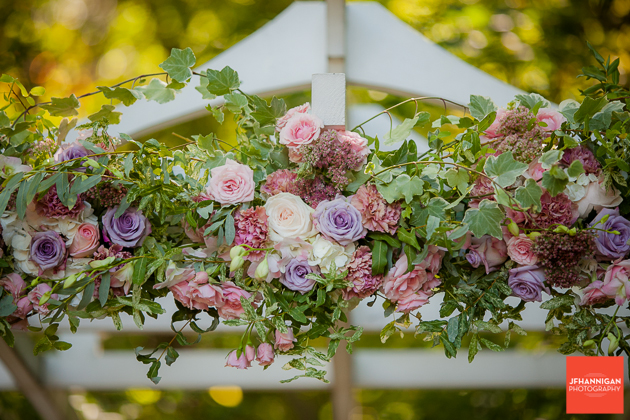 flowers in mauve and pink on wedding trellas