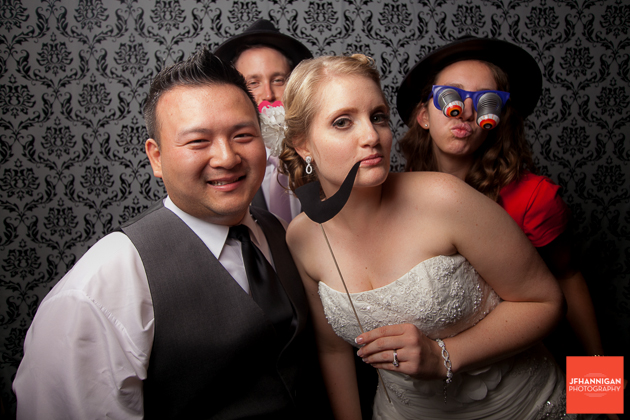 bride and groom and friends in photobooth