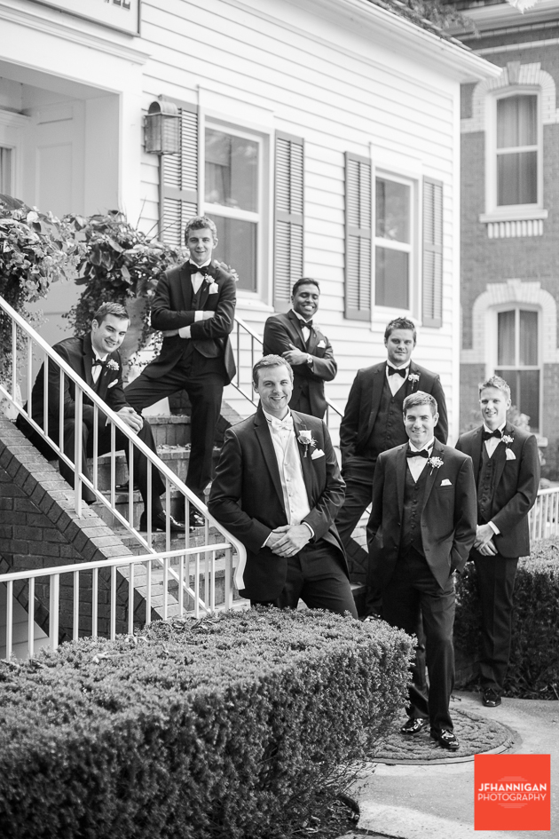 groom and ushers posed on stairs
