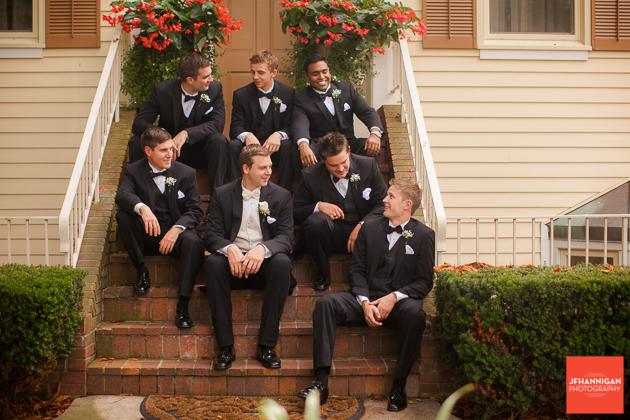 groom and ushers sitting on stairs