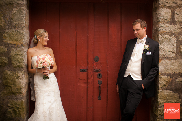 bride and groom in stone entrance way