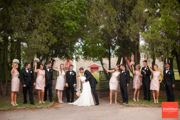 bridal party at entrance with stone building in background