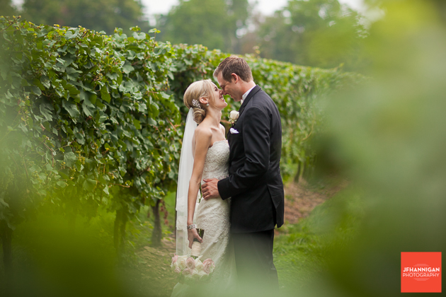 bride and groom with greenery of vineyard