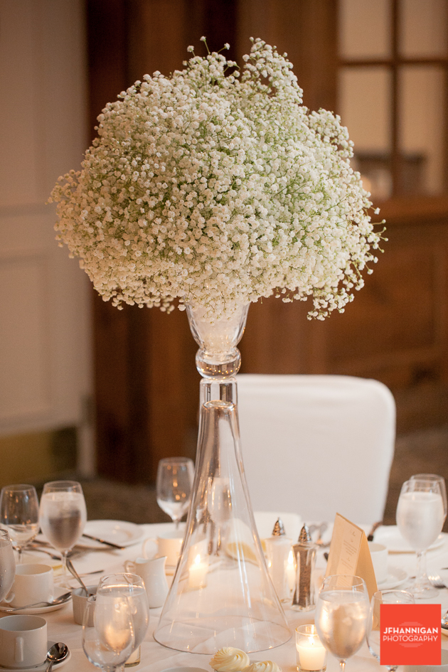 wedding reception flower arrangement using baby's breath