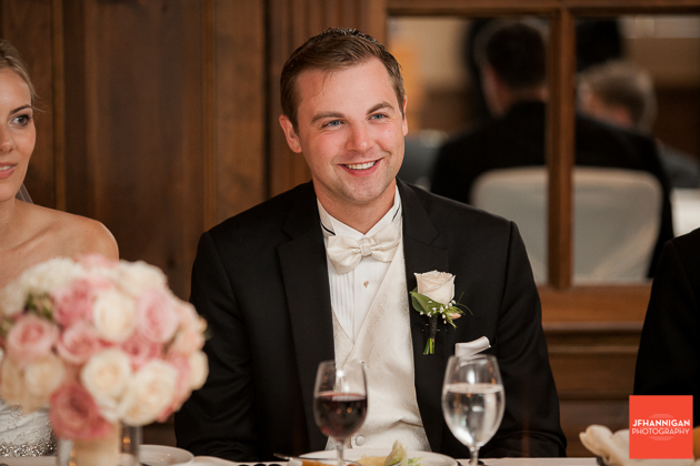 groom enjoys wedding reception speechs