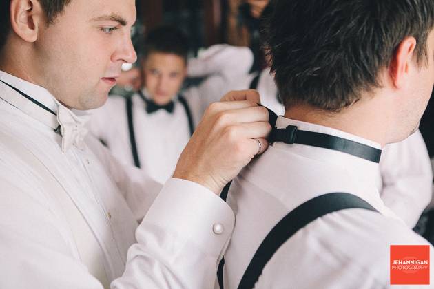 groomsmen put on bow ties