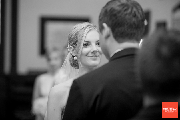 bride looks into groom's eyes during exchange of vows